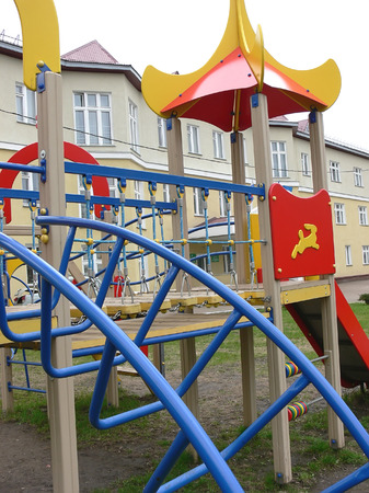 Children's playground near a building Stock Photo - 1577150