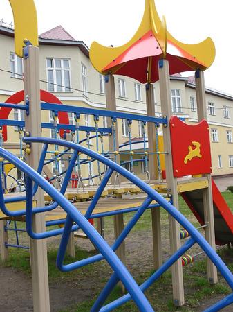 Children's playground near a building Stock Photo - 1577150