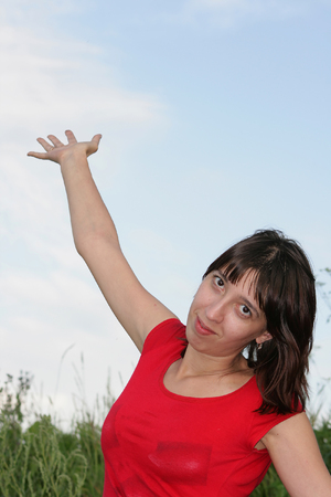 hand lifted: The young nice girl with the hand lifted upwards. On a hand it is easy to put any subject. Fine preparation for a collage.