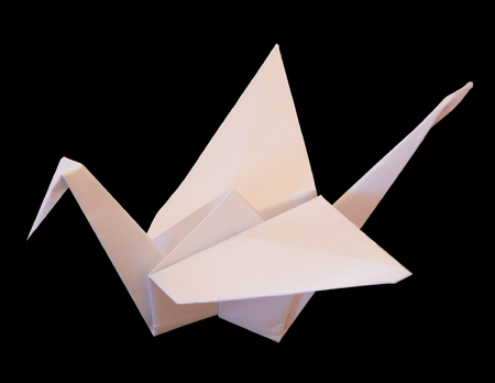 The crane made lea a paper. The image is placed on a black background for convenience of processing