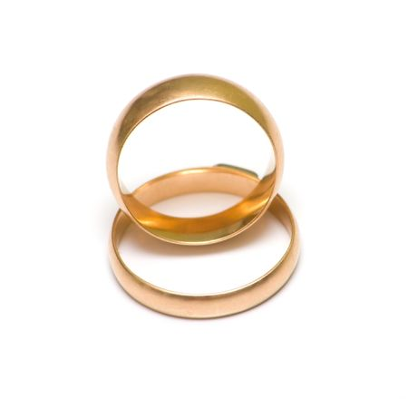 attribute: Pair wedding rings on white. The traditional attribute symbolizing registration of new . Shallow DOF. Isolation.