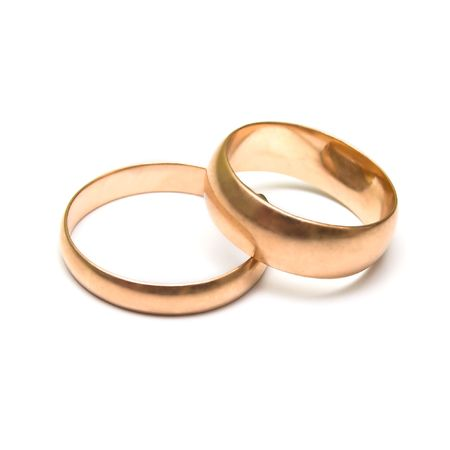 attribute: Pair wedding rings on white. The traditional attribute symbolizing registration of new  Stock Photo