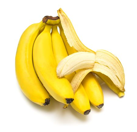 shallow dof: Cluster of ripe bananas. One banana is cleared away from a peel. Isolation, shallow DOF.