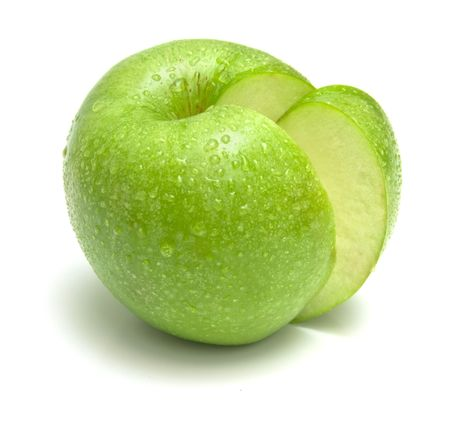 sweet segments: The ripe juicy apple covered by drops of water. Isolation on white, shallow DOF. Stock Photo