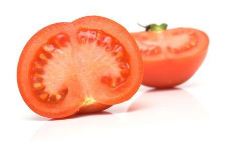 sweet segments: Perfect the tomatoes. Isolation on white. Shallow DOF.