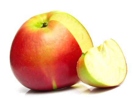 sweet segments: The ripe juicy red apple. Isolation on white, shallow DOF.