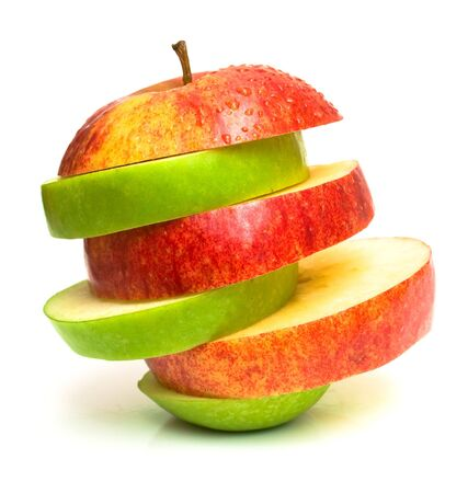 incompatible: The pyramid consisting of green and red apple. Isolation on white. Shallow DOF. Stock Photo
