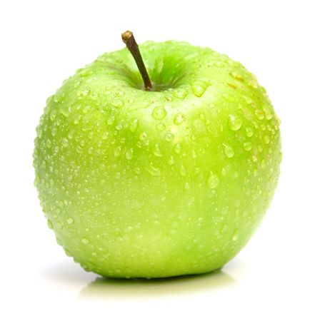 The ripe juicy green apple covered by drops of water. Isolation on white, shallow DOF.
