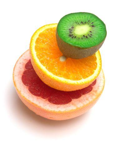 sweet segments: Allsorts from several tropical fruit on white. Shallow DOF. Isolation. Stock Photo