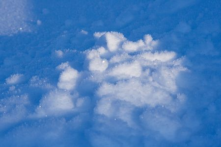 thawed: Thawed spring snow. Blue background.