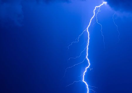 Photo of a lightning during a thunder-storm on a background of the dark dark blue sky Stock Photo