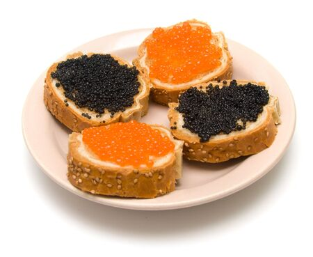Sandwiches with red and black fish caviar on a plate. Isolation, shallow DOF. photo