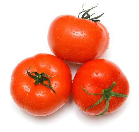 The perfect juicy tomatoes covered by drops of water. Isolation on white. Shallow DOF Stock Photo
