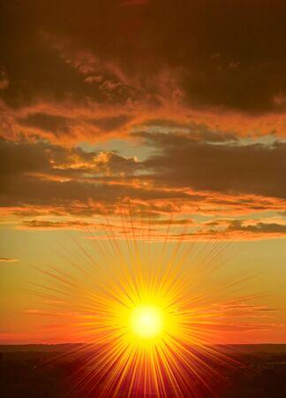 photomontage: Wonderful sunset with the cloudy sky. Photomontage. Stock Photo