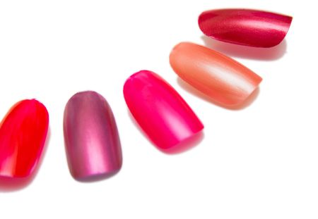 nuance: it lapped the models of colors for the nails. Isolation on the white.