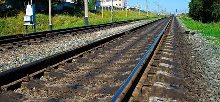 foreshortening: railroad in the summer period by closeup. Stock Photo