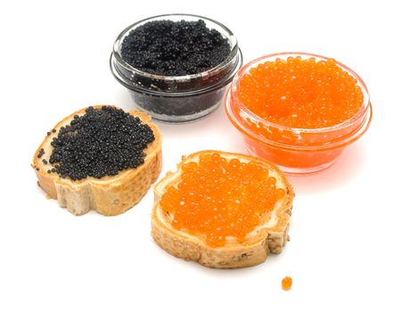 Red and black caviar on white. Dissertations stick out of jars with caviar metal. Isolation, shallow DOF. photo