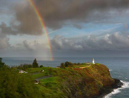 Pretty rainbow over Kilauea lighthouse at the North Shore of Kauai, Hawaii. photo