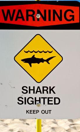 oahu: Warning, sharks sighted sign.