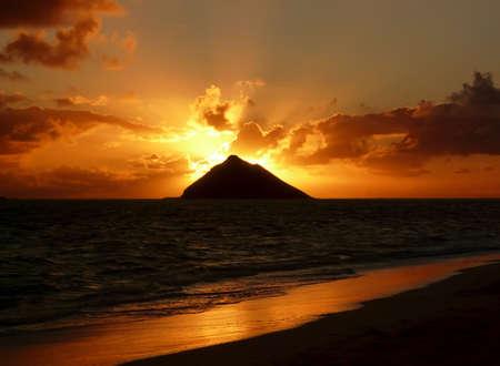 Warm tropical sunrise over an island at Lanikai Beach, Oahu, Hawaii. photo