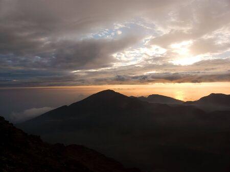 Sunrise over the lunar-like landscape of the dormant Haleakala crater, Maui, Hawaii. photo