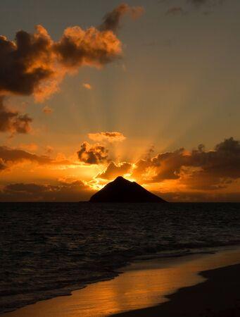 Tropical sunrise at Lanikai Beach, Oahu, Hawaii.