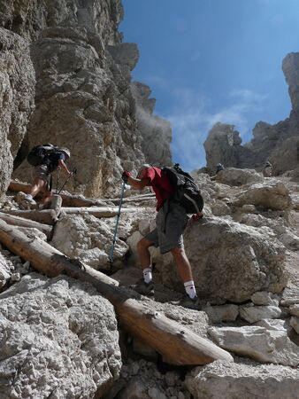 People hiking in the Dolomites, Italy photo