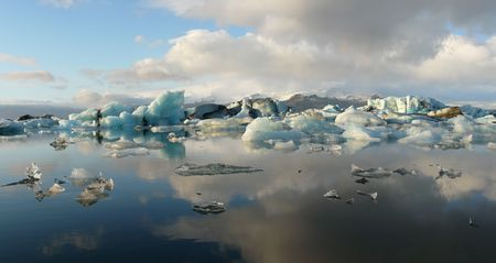 calving: Panorama of Jokulsarlon, glacier lake, in Iceland where icebergs collapsing from Vatnajokull glacier float around.