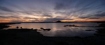 Sunset over tranquil Lake Myvatn, northern Iceland. Stock Photo - 6933705