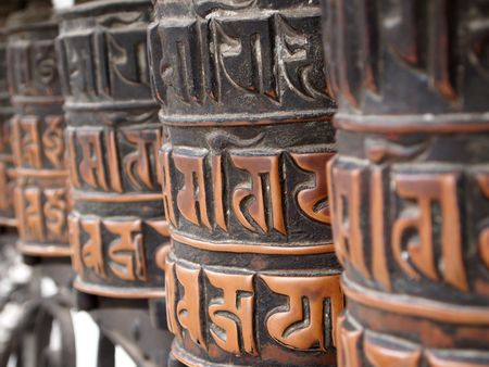 the stupa: Decorated buddhist prayer wheels in a stupa.