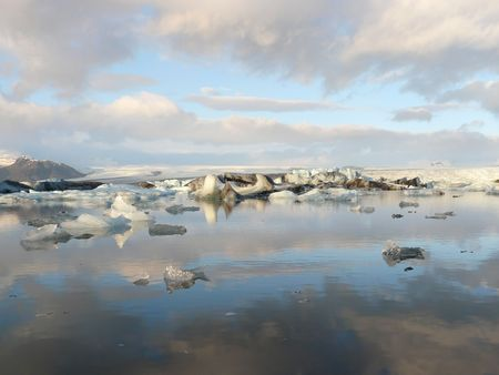 calving: Jokulsarlon, a lake in Iceland, where icebergs collapsing from Vatnajokull glacier float around. Stock Photo