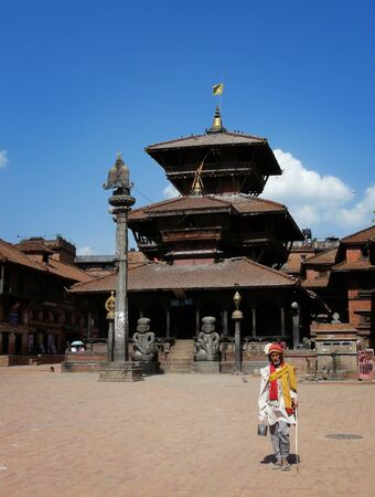 Bhaktapur, Nepal - May 13, 2010 : Famous holy man (sadhu) in front of the temple on Durbar Square, Bhaktapur, Nepal.