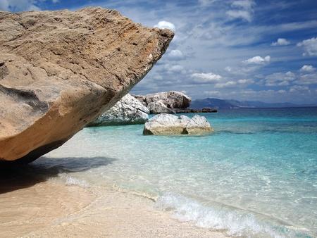 sardinia: Big rocks and emerald water at Cala Mariolu, a beach in the Sardinia, Italy.