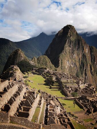 urubamba valley: Vertical overview of the ruins of the famous Inca city Machu Picchu in the sacred Urubamba valley near Cuzco in Peru.