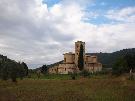 Famous church SantAntimo abbey or abbazia di SantAntimo near Montalcino in the Val dOrcia in Tuscany. Nowadays it is used as a monastery where monks live who sing daily gregorian chants. photo