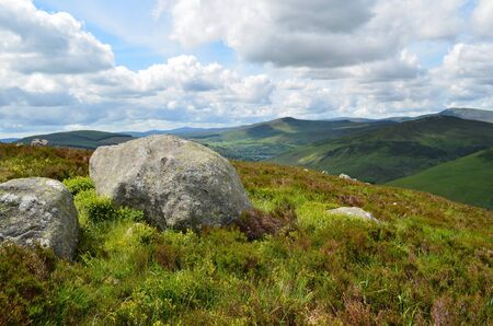 Big rocks in a typical green Irish landscape in Wicklow Mountains national park, south of Dublin in Ireland. photo