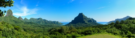 moorea: Panorama overview over Rotui mountain with Cook Bay and Opunohu Bay on the tropical pacific island of Moorea, near Tahiti in French Polynesia.