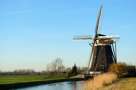dutch windmill: Landscape in Holland with a windmill and a canal.