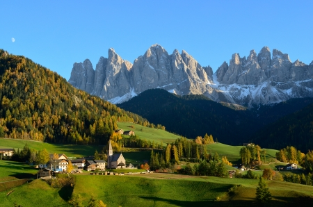 val: St. Magdalena or Santa Maddalena with its characteristic church in front of the Geisler or Odle Dolomites mountain peaks in the Val di Funes (Villnosstal) in Italy in autumn.