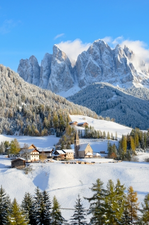 odle: St  Magdalena or Santa Maddalena with its characteristic church in front of the Geisler, Odle, dolomites mountain peaks in the Val di Funes  Villnosstal  in South Tyrol in Italy in winter