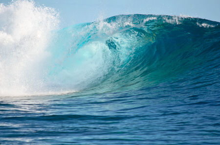 tahiti: A big wave break spray in the Pacific Ocean