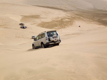 4wd: 4WD driving on a sand dune in the desert, called dune bashing, in the south of Qatar  Editorial