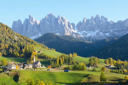 odle: St  Magdalena with its characteristic church in front of the Geisler Dolomites mountain peaks in the Villnosstal in Italy in autumn