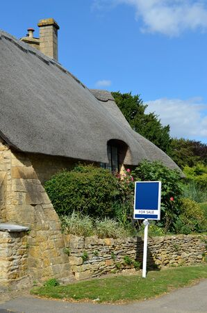 thatched house: Quaint thatched cottage for sale built out of Cotswold stone in the town of Chipping Campden in the Cotswolds, Gloucestershire, England, UK  Stock Photo