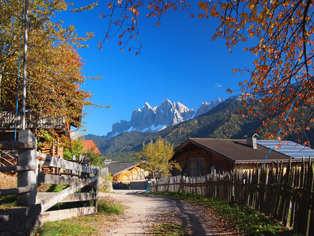 odle: A rural village in the Funes Valley  Val di Funes  with in the background the Odle Dolomites mountain peaks in autumn in South Tyrol in Italy