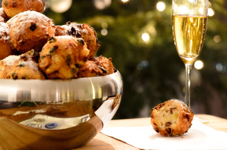Oliebollen, oil balls or donut balls, a dutch pastry traditionally eaten on New Year's Eve in the Netherlands   스톡 콘텐츠