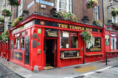 Dublin, Ireland - June 16, 2012: Famous red pub in the Temple Bar district in Dublin, Ireland on June 16, 2012.