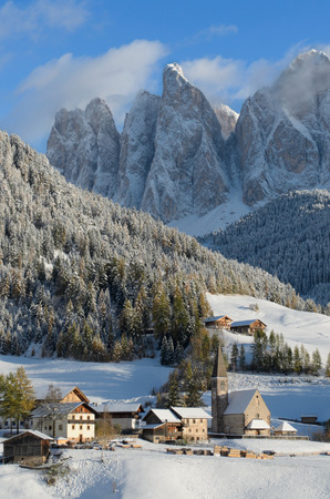 wintersport: The church of St. Magdalena or Santa Maddalena, a village in front of the Geisler or Odle dolomites mountain peaks in the Val di Funes (Villn�sser Tal) in South Tyrol in Italy in winter.