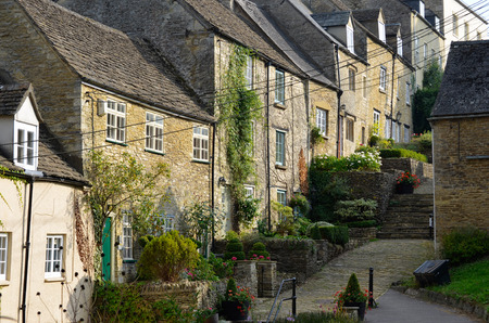 gloucestershire: The medieval architecture of the old Cotswold cottages of the Chipping Steps in Tetbury in Gloucestershire in the Cotswolds, England.