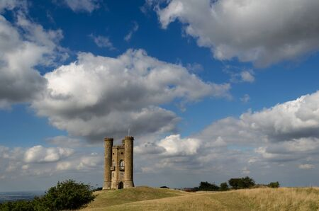broadway tower: Clouds in the sky over Broadway Tower on a hill in the Cotswolds in England, UK.
